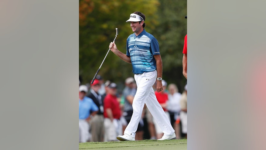 Bubba Watson smiles as he walks to the green on the first hole during the second round of play at the Tour Championship golf tournament at East Lake Golf Club Friday, Sept. 23, 2016, in Atlanta. (AP Photo/John Bazemore)
