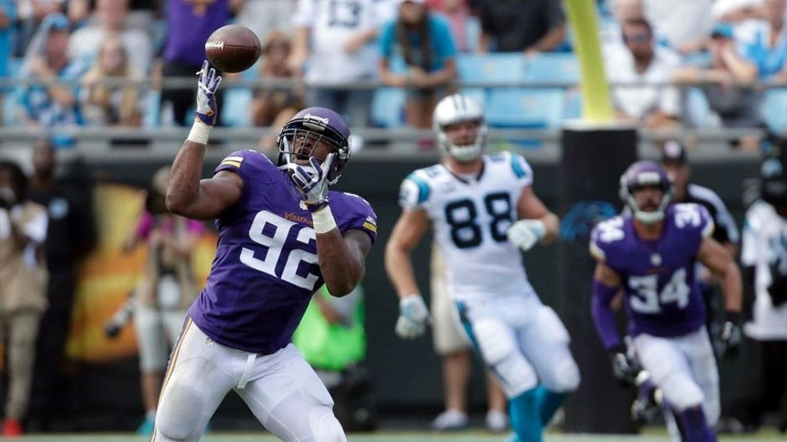 The Minnesota Vikings' Tom Johnson intercepts a Carolina Panthers pass in the second half in Charlotte, N.C., Sunday, Sept. 25, 2016. The Vikings won 22-10.