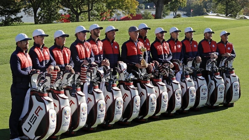 Members of the 2016 United States Ryder Cup team pose for a group photo before a practice round for the Ryder Cup golf tournament Tuesday, Sept. 27, 2016, at Hazeltine National Golf Club in Chaska, Minn. (AP Photo/Chris Carlson)