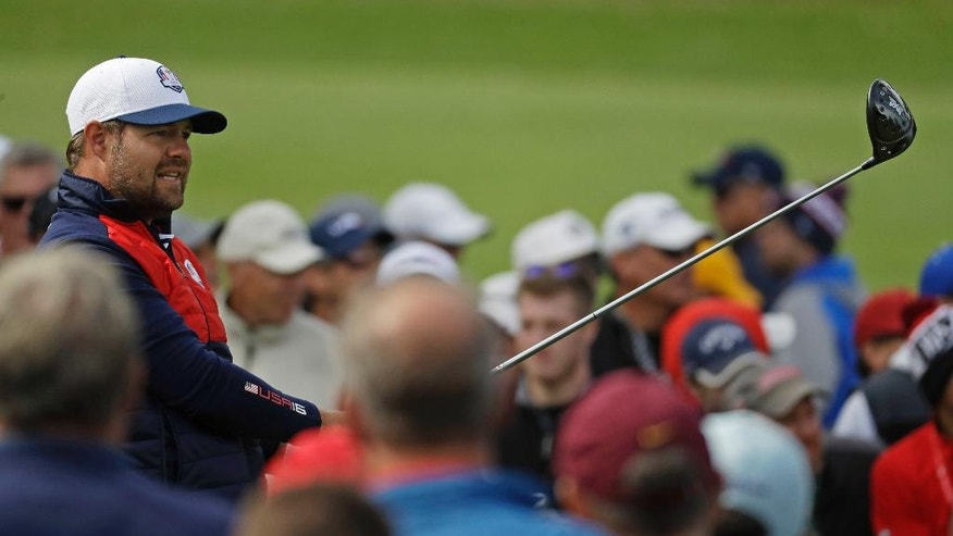 United States' Ryan Moore watches a shot on the sixth hole during a practice round for the Ryder Cup golf tournament Tuesday, Sept. 27, 2016, at Hazeltine National Golf Club in Chaska, Minn. (AP Photo/Chris Carlson)