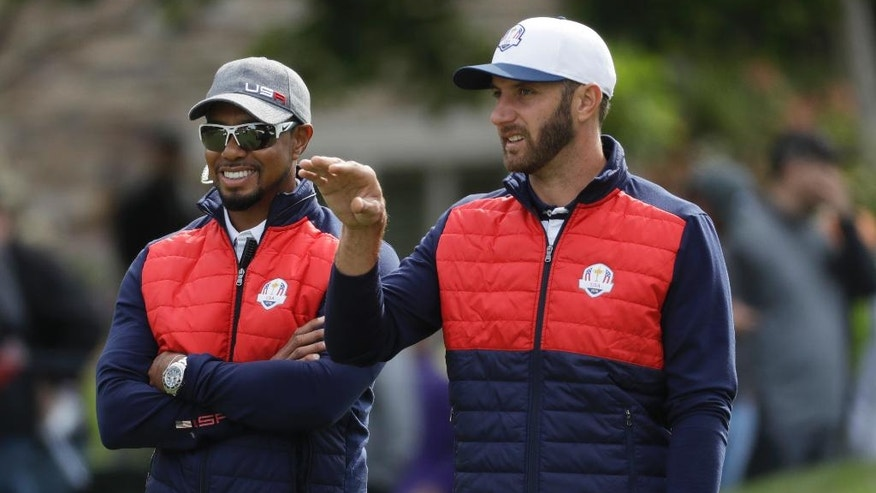 United States' Dustin Johnson talks to United States vice-captain Tiger Woods on the fifth hole during a practice round for the Ryder Cup golf tournament Tuesday, Sept. 27, 2016, at Hazeltine National Golf Club in Chaska, Minn. (AP Photo/Chris Carlson)