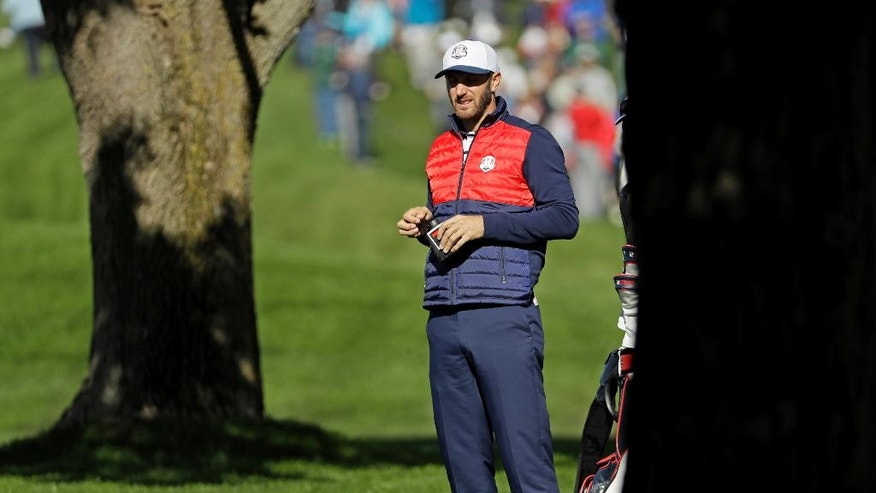 United States' Dustin Johnson looks over a shot on the first hole during a practice round for the Ryder Cup golf tournament Tuesday, Sept. 27, 2016, at Hazeltine National Golf Club in Chaska, Minn. (AP Photo/David J. Phillip)