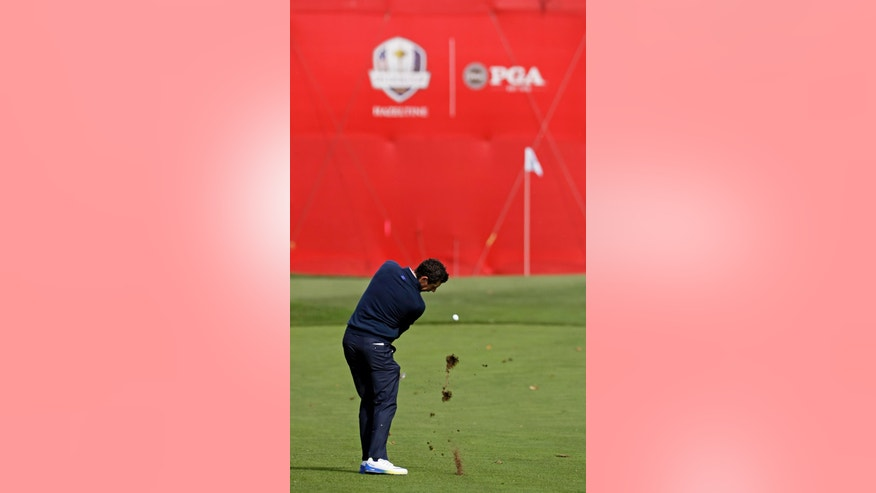 Europe's Rory McIlroy hits to the fifth green during a practice round for the Ryder Cup golf tournament Tuesday, Sept. 27, 2016, at Hazeltine National Golf Club in Chaska, Minn. (AP Photo/Chris Carlson)