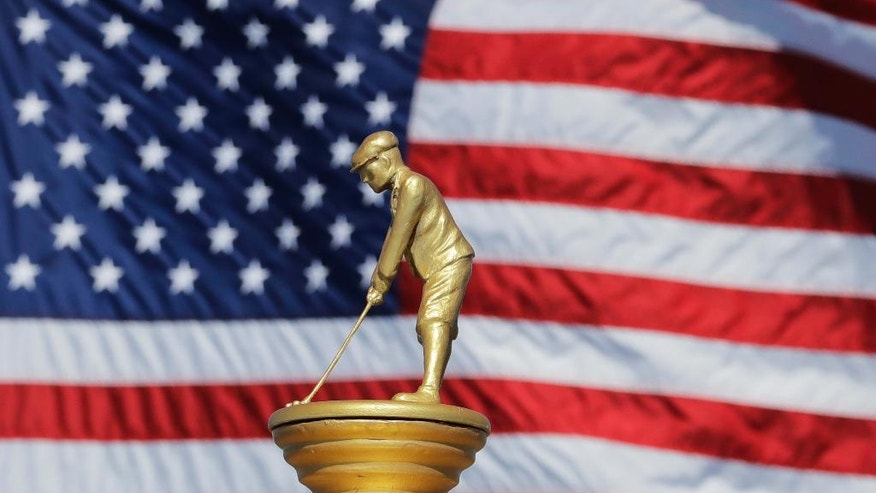 A replica of the Ryder Cup is seen Monday, Sept. 26, 2016, at Hazeltine National Golf Club in Chaska, Minn. (AP Photo/Charlie Riedel)