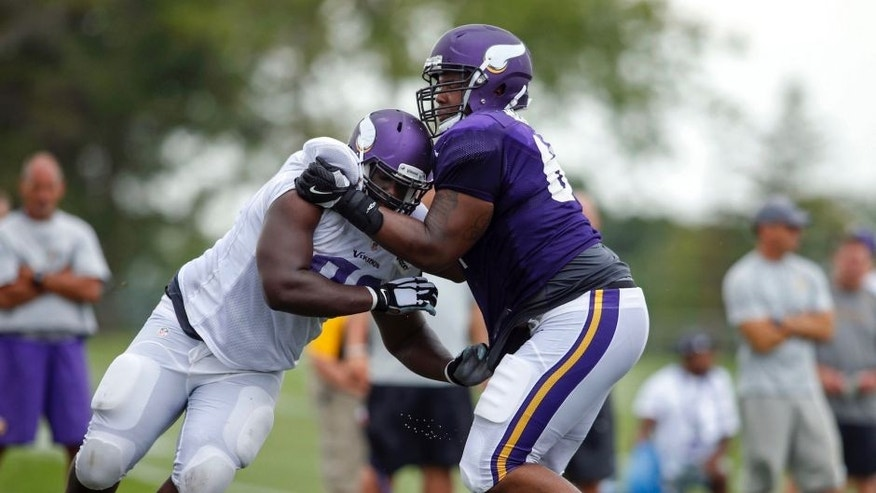 <p>Minnesota Vikings defensive tackle Shamar Stephen (left) tries to get around guard Willie Beavers (right) in drills during training camp on Aug. 1 in Mankato, Minn.</p>