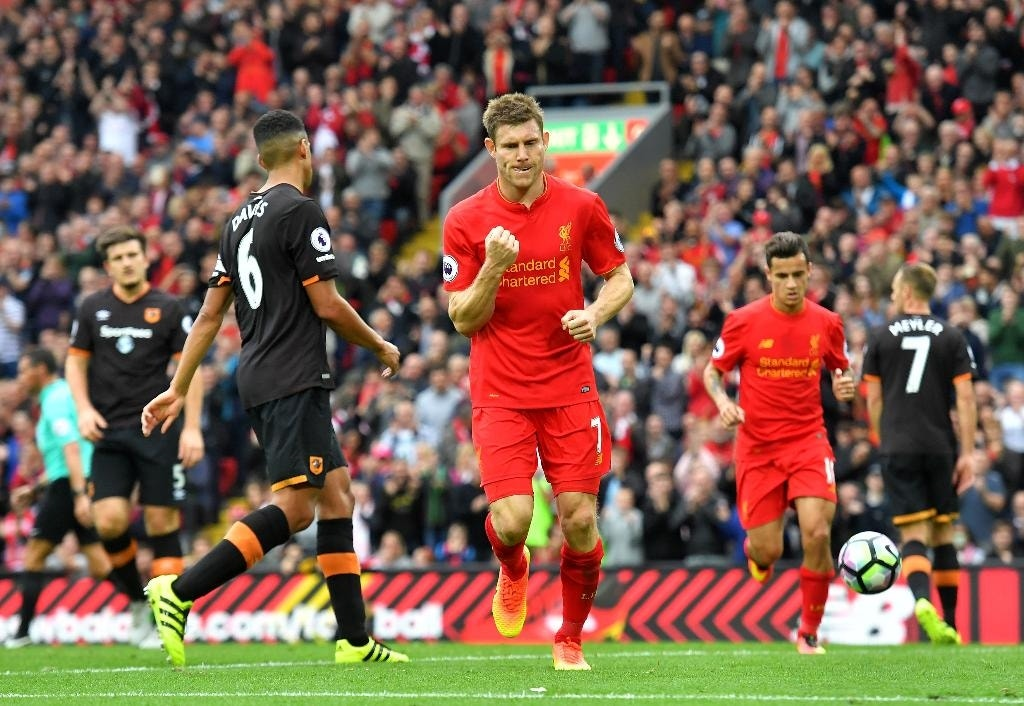 Liverpool's James Milner celebrates scoring his team's fifth goal from the penalty spot during the English Premier League soccer match between Liverpool and Hull City at Anfield Stadium in Liverpool, England, Saturday, Sept, 24, 2016. (Dave Howarth/PA via AP)