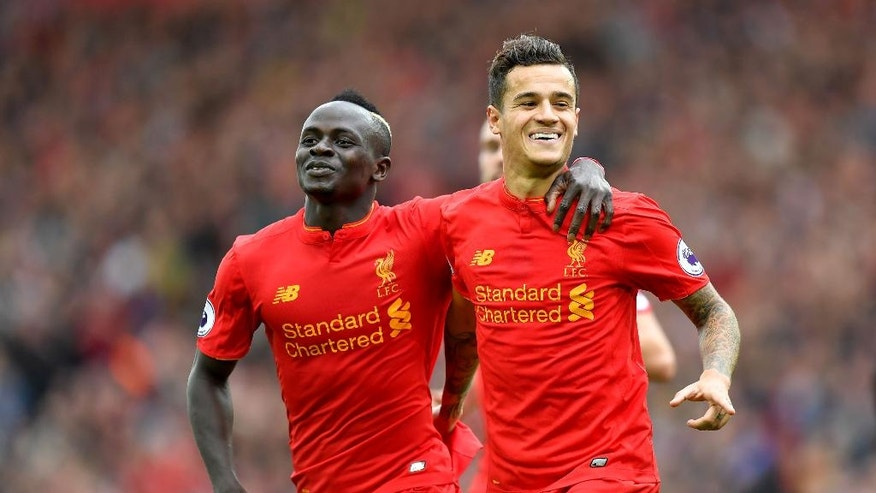 Liverpool's Philippe Coutinho, right, celebrates scoring his side's fourth goal of the game with Sadio Mane during their Premier League match Liverpool versus Hull City at Anfield, Liverpool, England, Saturday Sept. 24, 2016. (Dave Howarth/PA via AP)