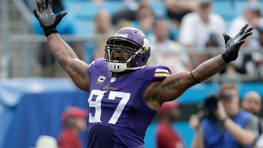 The Minnesota Vikings' Everson Griffen celebrates after a sack against the Carolina Panthers in the second half in Charlotte, N.C.