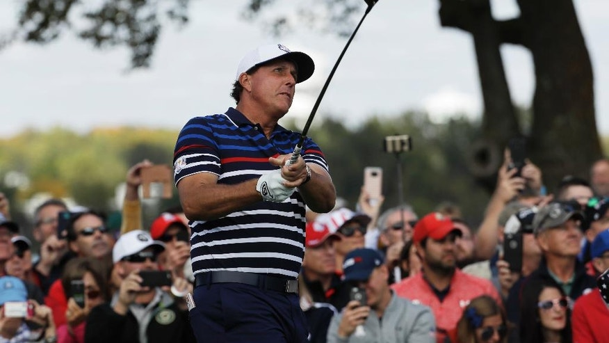 United States' Phil Mickelson hits on the 11th hole during a practice round for the Ryder Cup golf tournament Thursday, Sept. 29, 2016, at Hazeltine National Golf Club in Chaska, Minn. (AP Photo/David J. Phillip)