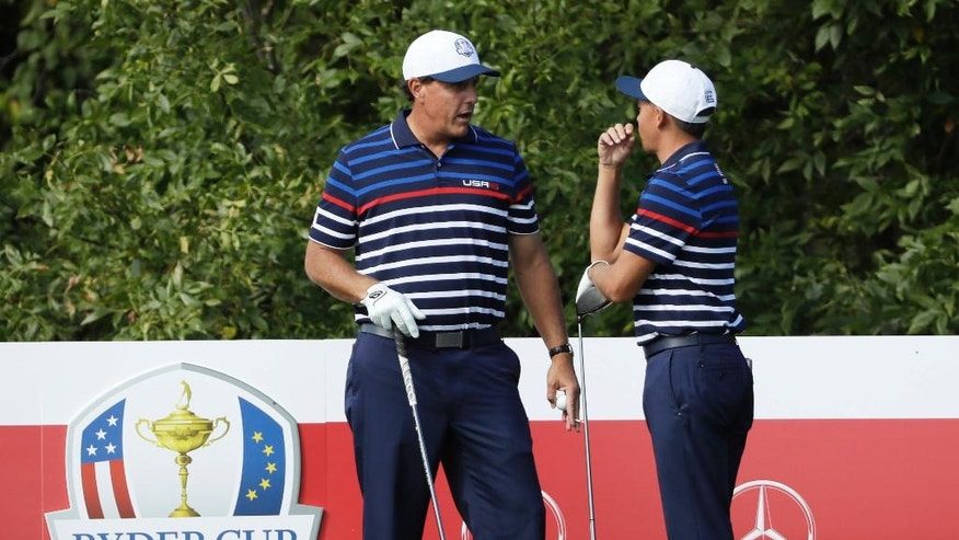 United States' Phil Mickelson talks to United States' Rickie Fowler during a practice round for the Ryder Cup golf tournament Thursday, Sept. 29, 2016, at Hazeltine National Golf Club in Chaska, Minn. (AP Photo/David J. Phillip)