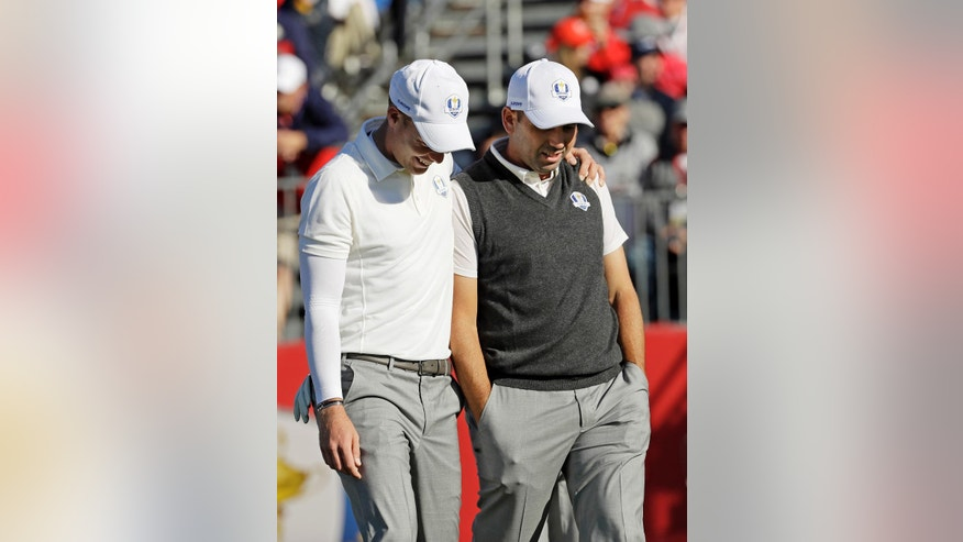 Europe's Danny Willett talks to Europe's Sergio Garcia on the first tee during a practice round for the Ryder Cup golf tournament Thursday, Sept. 29, 2016, at Hazeltine National Golf Club in Chaska, Minn. (AP Photo/David J. Phillip)