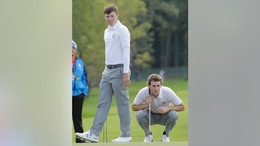 Europe's Matthew Fitzpatrick and Europe's Thomas Pieters putt on the sixth hole during a practice round for the Ryder Cup golf tournament Thursday, Sept. 29, 2016, at Hazeltine National Golf Club in Chaska, Minn. (AP Photo/Charlie Riedel)