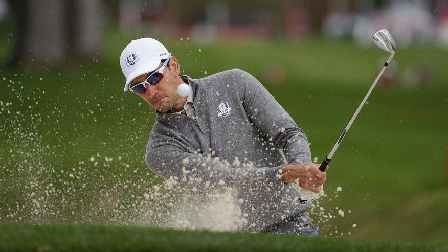 Europe's Rafa Cabrera Bello hits from a bunker on the 12th hole during a practice round for the Ryder Cup golf tournament Wednesday, Sept. 28, 2016, at Hazeltine National Golf Club in Chaska, Minn. (AP Photo/Chris Carlson)
