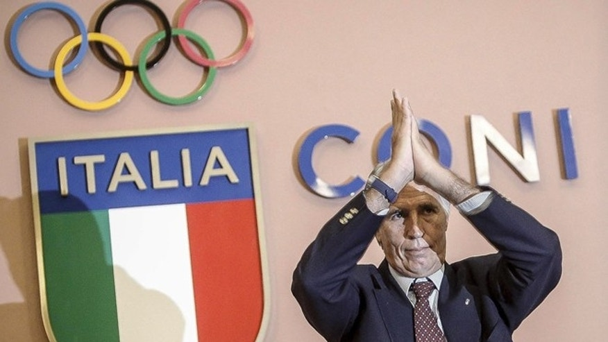 In this Wednesday, Sept. 21, 2016 file photo, CONI (Italian Olympic Committee) President Giovanni Malago' applauds during a press conference at the CONI headquarters in Rome.