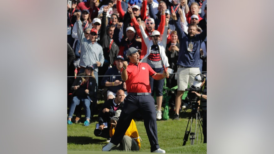 United States' Patrick Reed reacts after making a putt and winning his match 3 & 2 on the 16th hole during a foresomes match at the Ryder Cup golf tournament Friday, Sept. 30, 2016, at Hazeltine National Golf Club in Chaska, Minn. (AP Photo/Charlie Riedel)