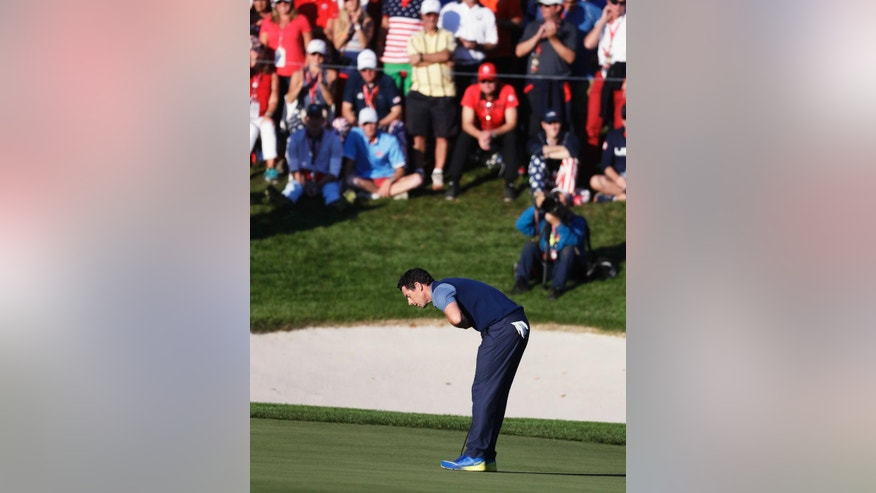 Europe's Rory McIlroy bows after making his putt to win his match 3 & 2 during a four-balls match at the Ryder Cup golf tournament Friday, Sept. 30, 2016, at Hazeltine National Golf Club in Chaska, Minn. (AP Photo/Chris Carlson)