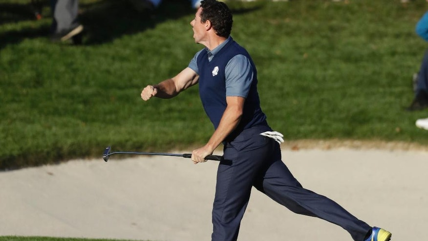 Europe's Rory McIlroy reacts after making his putt to win his match 3 & 2 during a four-balls match at the Ryder Cup golf tournament Friday, Sept. 30, 2016, at Hazeltine National Golf Club in Chaska, Minn. (AP Photo/Chris Carlson)