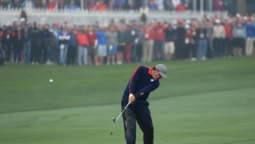 United States' Phil Mickelson hits a shot on the first hole during a foresomes match at the Ryder Cup golf tournament Friday, Sept. 30, 2016, at Hazeltine National Golf Club in Chaska, Minn. (AP Photo/Charlie Riedel)