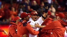 Sep 29, 2016; St. Louis, MO, USA; St. Louis Cardinals catcher Yadier Molina (4) celebrates after hitting a walk off double off of Cincinnati Reds relief pitcher Blake Wood (not pictured) during the ninth inning at Busch Stadium. The Cardinals won 4-3. Mandatory Credit: Jeff Curry-USA TODAY Sports