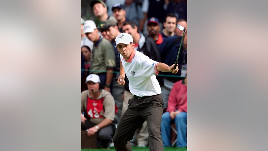 FILE - In this Sept. 25, 1999, file photo, European Ryder Cup player Sergio Garcia reacts as he watches his putt drop in to win the 10th hole during U.S. Ryder Cup action in foursomes competition, Saturday, Sept. 25, 1999, at The Country Club in Brookline, Mass. Garcia and Paul Lawrie helped put Europe in command early, capturing the first two points and accounting for 3 1/2 of the team's opening-day total of six points. Both finished strong as well, with 3-1-1 records. (AP Photo/Elise Amendola)