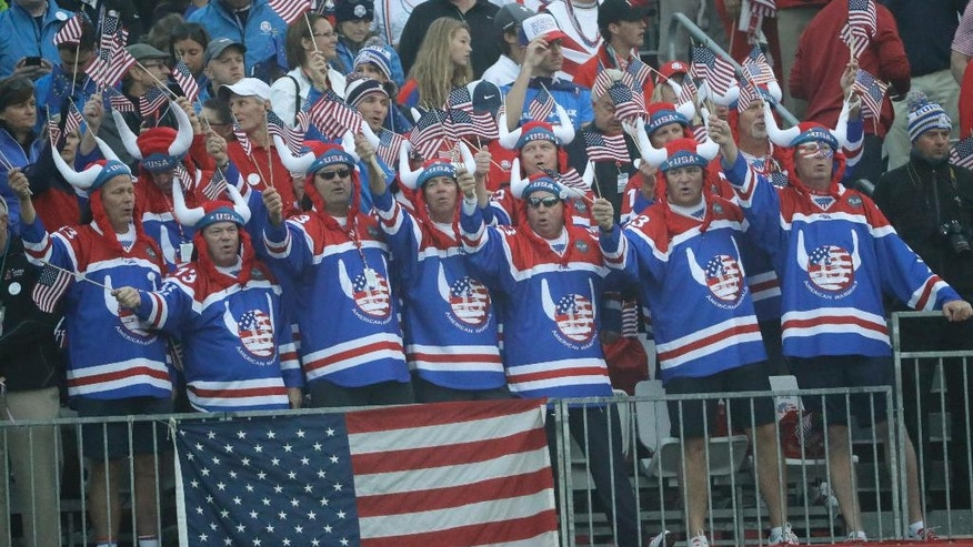 Fans wait for the start of the foresomes matches at the Ryder Cup golf tournament Friday, Sept. 30, 2016, at Hazeltine National Golf Club in Chaska, Minn. (AP Photo/David J. Phillip)