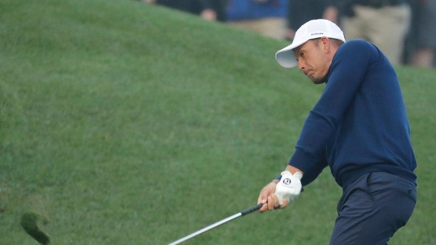 Europe's Henrik Stenson hits from the first fairway during a foresomes match at the Ryder Cup golf tournament Friday, Sept. 30, 2016, at Hazeltine National Golf Club in Chaska, Minn. (AP Photo/Charlie Riedel)