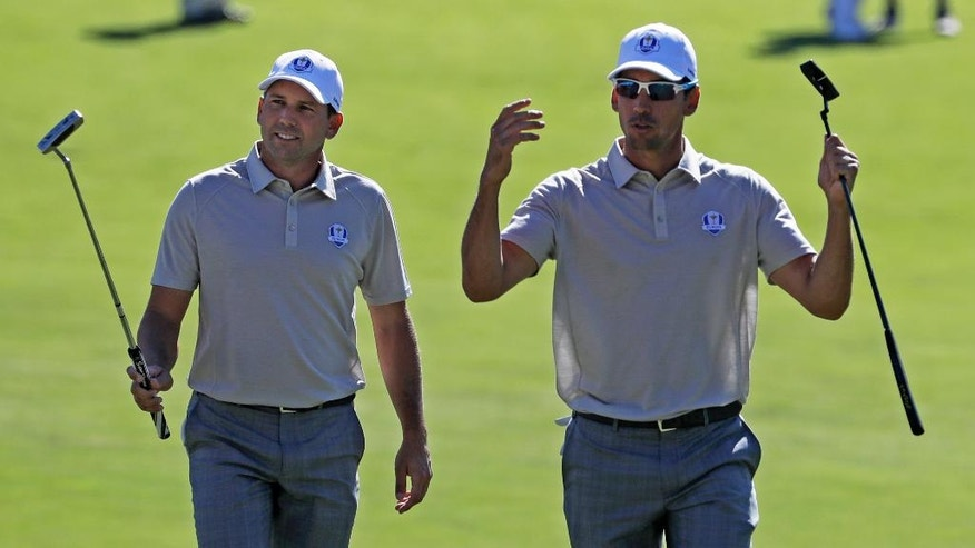 Europe's Rafa Cabrera Bello and Europe's Sergio Garcia walk up 15 during a foresomes match at the Ryder Cup golf tournament Saturday, Oct. 1, 2016, at Hazeltine National Golf Club in Chaska, Minn. (AP Photo/Chris Carlson)