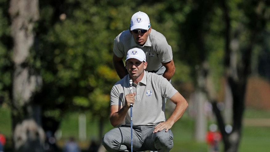 Europe's Rafa Cabrera Bello and Europe's Sergio Garcia line up a putt on the 14th hole during a foresomes match at the Ryder Cup golf tournament Saturday, Oct. 1, 2016, at Hazeltine National Golf Club in Chaska, Minn. (AP Photo/Chris Carlson)