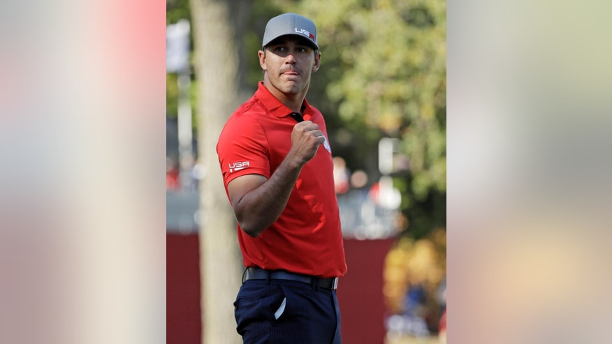 United States' Brooks Koepka reacts to his birdie putt on the eighth hole during a four-balls match at the Ryder Cup golf tournament Friday, Sept. 30, 2016, at Hazeltine National Golf Club in Chaska, Minn. (AP Photo/David J. Phillip)