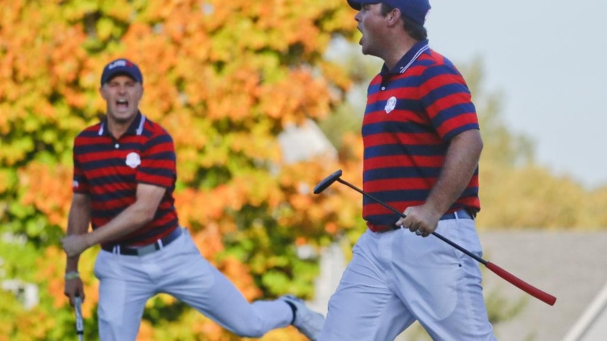 United States' Patrick Reed celebrates his birdie on the 14th hole with United States' Jordan Spieth during a four-ball match at the Ryder Cup golf tournament Saturday, Oct. 1, 2016, at Hazeltine National Golf Club in Chaska, Minn. (AP Photo/Chris Carlson)