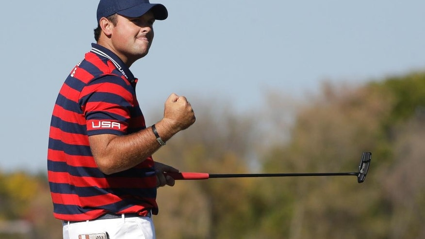 United States' Patrick Reed celebrates his putt on the seventh hole during a four-ball match at the Ryder Cup golf tournament Saturday, Oct. 1, 2016, at Hazeltine National Golf Club in Chaska, Minn. (AP Photo/Chris Carlson)