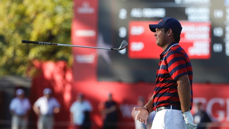 United States' Patrick Reed flips his club on the 12th hole during a four-ball match at the Ryder Cup golf tournament Saturday, Oct. 1, 2016, at Hazeltine National Golf Club in Chaska, Minn. (AP Photo/Chris Carlson)