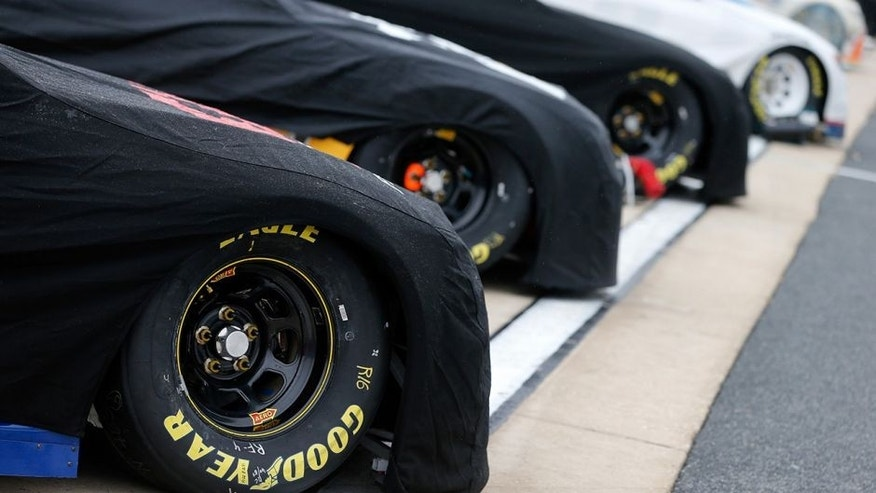 DOVER, DE - SEPTEMBER 30: Cars sit on the grid prior to qualifying for the NASCAR Sprint Cup Series Citizen Solider 400 at Dover International Speedway on September 30, 2016 in Dover, Delaware. Qualifying was cancelled due to weather.(Photo by Brian Lawdermilk/Getty Images)
