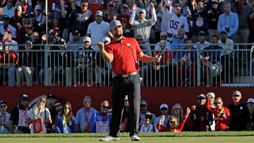 United States' Ryan Moore reacts to a birdie putt on the 14th hole during a four-balls match at the Ryder Cup golf tournament Friday, Sept. 30, 2016, at Hazeltine National Golf Club in Chaska, Minn. (AP Photo/David J. Phillip)