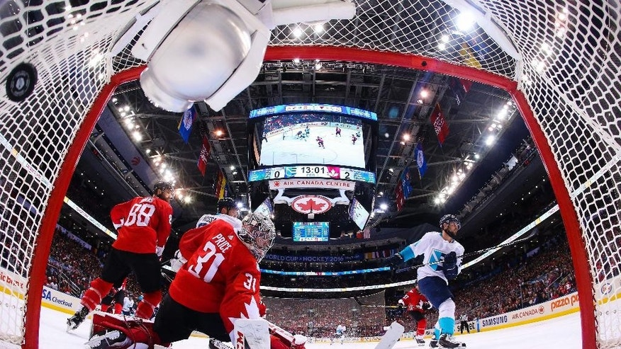 FILE - In this Sept. 27, 2016, file pool photo, Europe forward Tomas Tatar (21) scores past Canada goalie Carey Price (31) during the second period of Game 1 of the World Cup of Hockey finals in Toronto. The World Cup of Hockey is going to help some of the league's top stars start the season at a high level, coming off a best-on-best tournament. (Bruce Bennett/Pool Photo via AP, File)