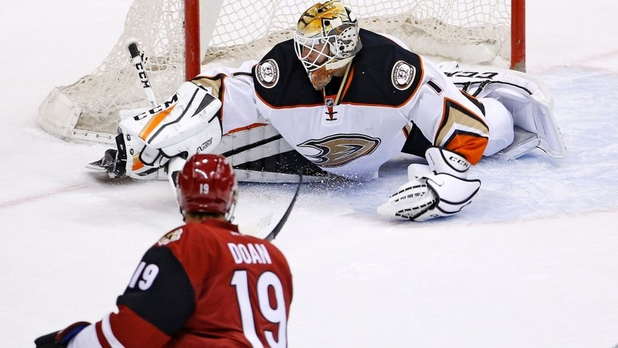 Arizona Coyotes' Shane Doan (19) scores the game-winning goal against Anaheim Ducks goalie Jonathan Bernier (1) during overtime of a preseason NHL hockey game Saturday, Oct. 1, 2016, in Glendale, Ariz. The Coyotes defeated the Ducks 3-2. (AP Photo/Ross D. Franklin)