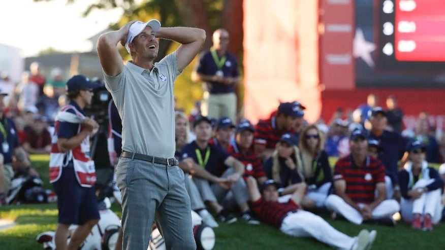Europe's Henrik Stenson reacts after missing his birdie putt on the 17th hole during a four-ball match at the Ryder Cup golf tournament Saturday, Oct. 1, 2016, at Hazeltine National Golf Club in Chaska, Minn. (AP Photo/Chris Carlson)
