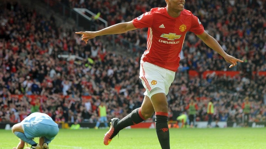 Manchester United's Anthony Martial celebrates after scoring during the English Premier League soccer match between Manchester United and Stoke City at Old Trafford in Manchester, England, Sunday, Oct. 2, 2016. (AP Photo/Rui Vieira)