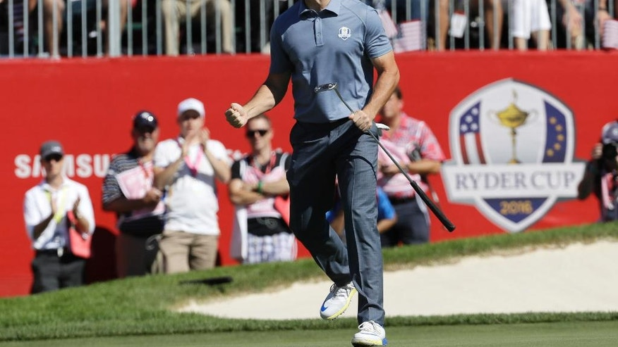 Europe's Rory McIlroy reacts after making a birdie putt on the sixth hole during a singles match at the Ryder Cup golf tournament Sunday, Oct. 2, 2016, at Hazeltine National Golf Club in Chaska, Minn. (AP Photo/David J. Phillip)