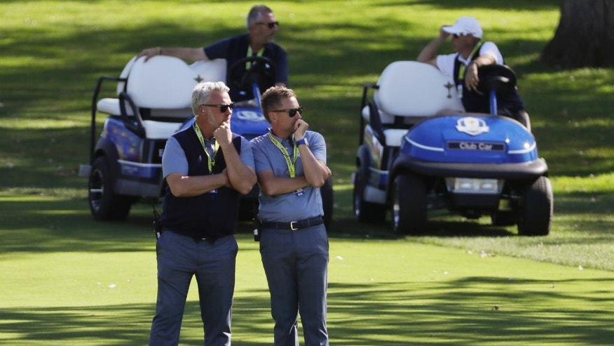 Europe captain Darren Clarke and Europe vice-captain Ian Poulter watch during a singles match at the Ryder Cup golf tournament Sunday, Oct. 2, 2016, at Hazeltine National Golf Club in Chaska, Minn. (AP Photo/David J. Phillip)