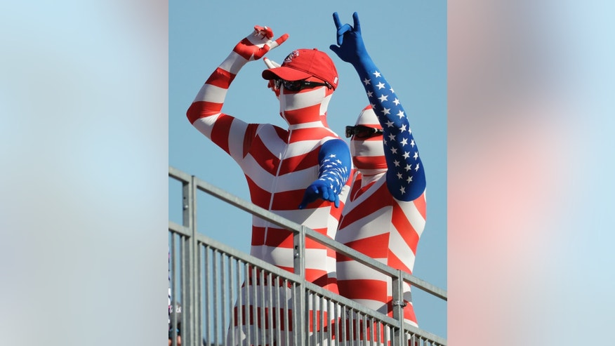 Fans cheer during a four-ball match at the Ryder Cup golf tournament Saturday, Oct. 1, 2016, at Hazeltine National Golf Club in Chaska, Minn. (AP Photo/Charlie Riedel)