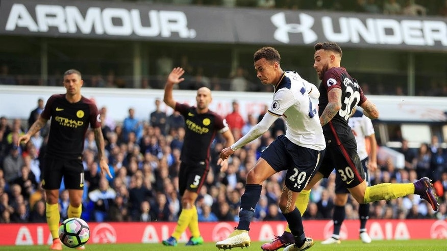 Tottenham Hotspur's Dele Alli, centre, scores during the English Premier League soccer match between Tottenham Hotspur and Manchester City at White Hart Lane, London, Sunday, Oct. 2, 2016. (John Walton/PA via AP)