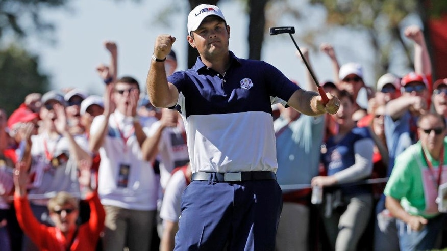 United States' Patrick Reed reacts after winning the fifth hole during a singles match at the Ryder Cup golf tournament Sunday, Oct. 2, 2016, at Hazeltine National Golf Club in Chaska, Minn. (AP Photo/David J. Phillip)