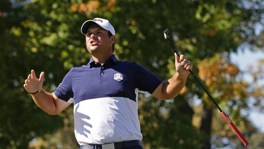 United States' Patrick Reed reacts after winning the 12th hole during a singles match at the Ryder Cup golf tournament Sunday, Oct. 2, 2016, at Hazeltine National Golf Club in Chaska, Minn. (AP Photo/David J. Phillip)