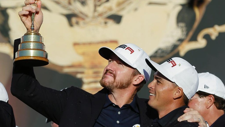 United States' Rickie Fowler and United States' Jimmy Walker celebrate during the closing ceremony of the Ryder Cup golf tournament Sunday, Oct. 2, 2016, at Hazeltine National Golf Club in Chaska, Minn. (AP Photo/David J. Phillip)