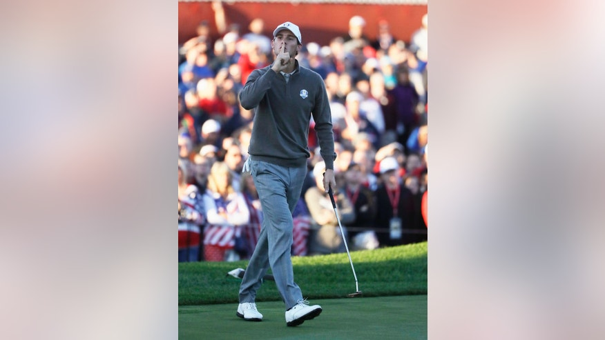 Europe's Thomas Pieters silences the crowd after his birdie putt on the first hole during a foresomes match at the Ryder Cup golf tournament Saturday, Oct. 1, 2016, at Hazeltine National Golf Club in Chaska, Minn. (AP Photo/Chris Carlson)