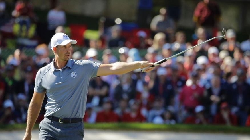 Europe's Henrik Stenson reacts after making his puty on the 15th hole during a singles match at the Ryder Cup golf tournament Sunday, Oct. 2, 2016, at Hazeltine National Golf Club in Chaska, Minn. (AP Photo/Charlie Riedel)