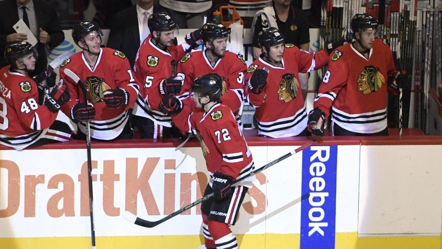 Chicago Blackhawks left wing Artemi Panarin (72) celebrates his goal against St. Louis Blues with his teammates during the second period of an NHL hockey preseason game Saturday, Oct. 1, 2016, in Chicago. (AP Photo/David Banks)
