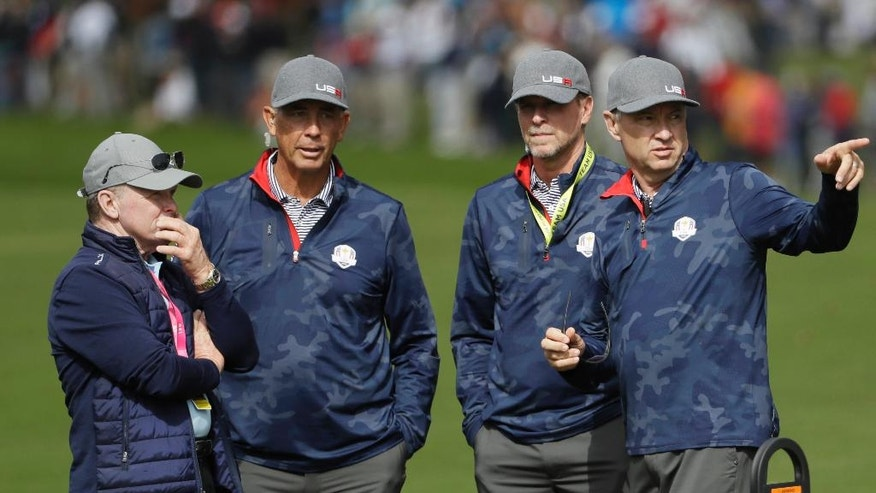 United States captain Davis Love III, right to left, talks to United States vice-captain Steve Stricker, United States vice-captain Tom Lehman and Tom Kite during a practice round for the Ryder Cup golf tournament Thursday, Sept. 29, 2016, at Hazeltine National Golf Club in Chaska, Minn. (AP Photo/David J. Phillip)