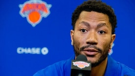 FILE - In this June 24, 2016, file photo, Derrick Rose speaks during a news conference at Madison Square Garden in New York. The NBA star Rose is due in a Los Angeles courtroom on Tuesday, Oct. 4, to fight a $21 million lawsuit by a former girlfriend who accuses him and two friends of gang raping her three years ago when she was incapacitated. The start of the trial in U.S. District Court conflicts with the Knicks preseason opener in Houston and it's not clear which Rose will attend. (AP Photo/Mary Altaffer, File)